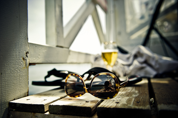 sunglasses, wine and sun © Janis Ratnieks Photography