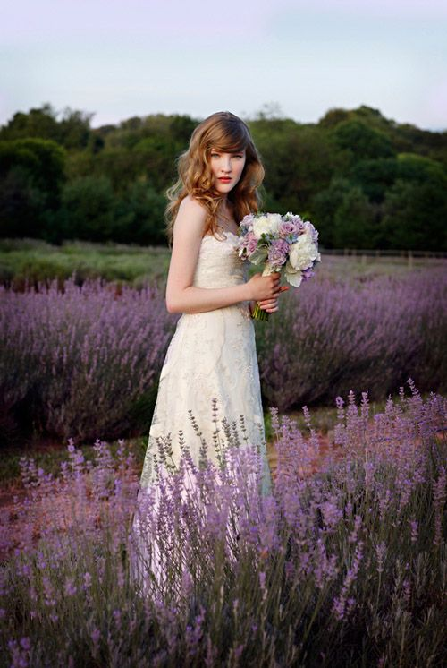 bride in field of lavender with lavender inspired bouquet