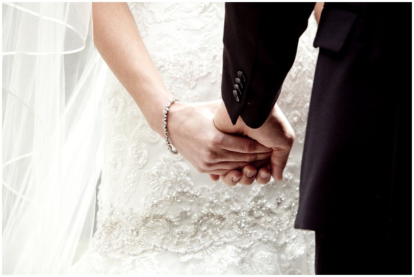 bride groom holding hands
