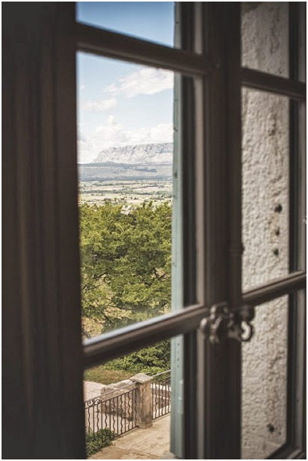 provence through window | Photography © Jean-Louis Brun, Styling by Fête in France on French Wedding Style Blog
