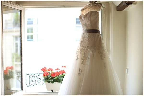 La Sposa wedding dress hanging up, waiting for wedding day