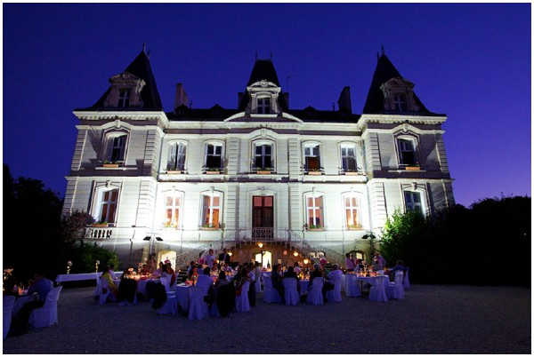 beautiful chateau as backdrop to evening wedding reception