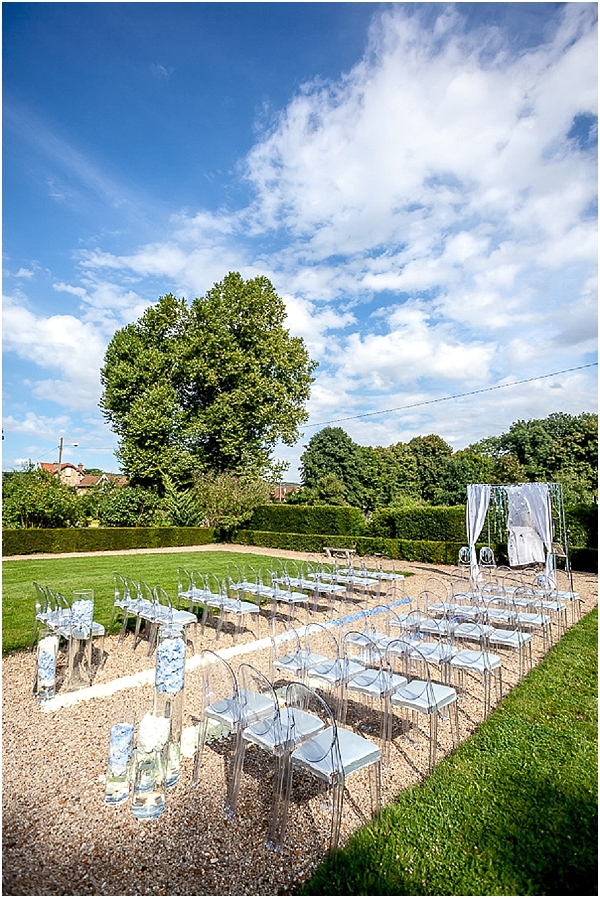 clear chairs outdoor ceremony