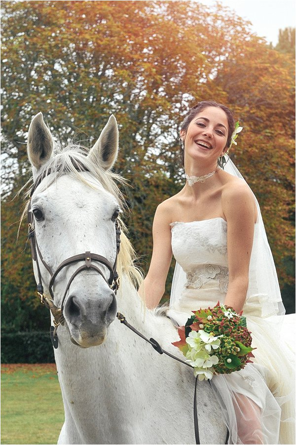 bride arriving on a horse