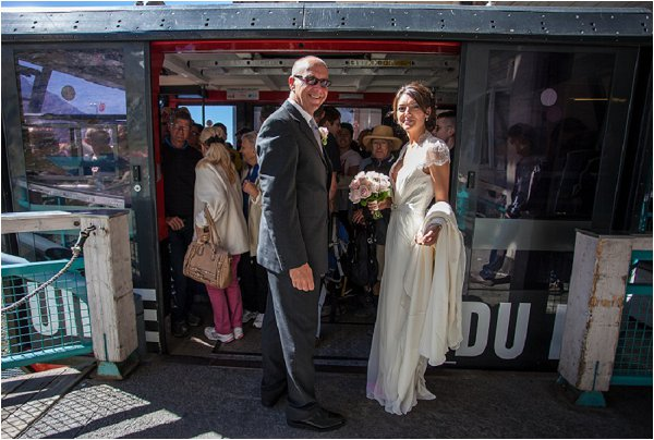 bride and father getting on cable car
