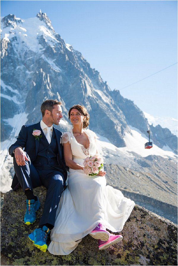 bride & groom with cable car in the background