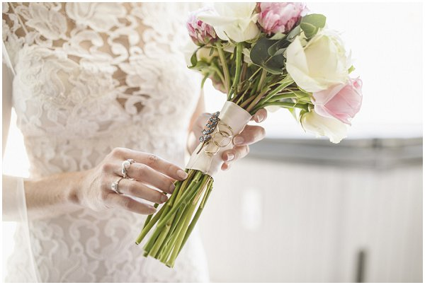 attaching jewels to wedding bouquet