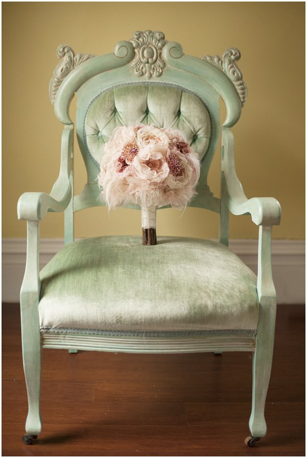 pink wedding bouquet on mint green chair