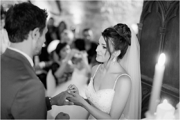 Beautiful Bride giving her groom his ring