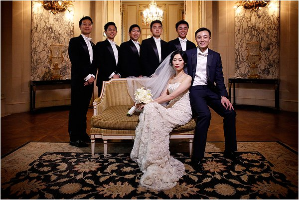 Elegant bride with her groom and groomsmen