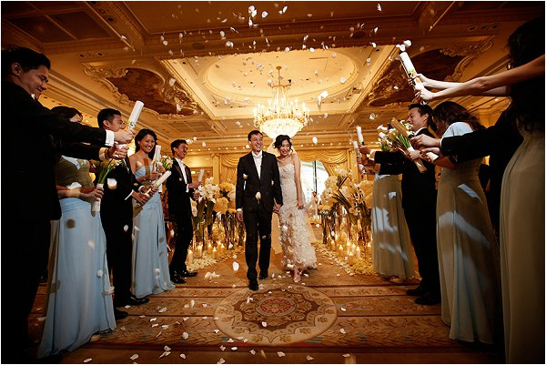 Throwing confetti over the bride and groom at Shangri-La Hotel Paris