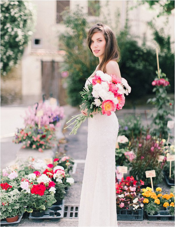 Bride chooses her own pink and white bouquet of peonies at Provencal market