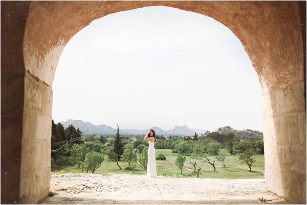 Bride stood in the sprawling grounds of Mas de la Rose in Provence