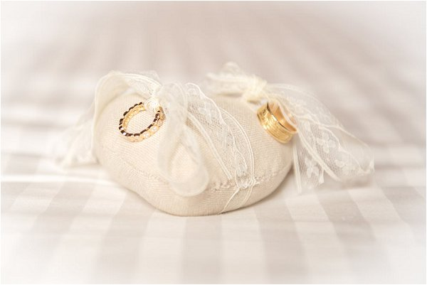 Gold wedding rings presented with lace