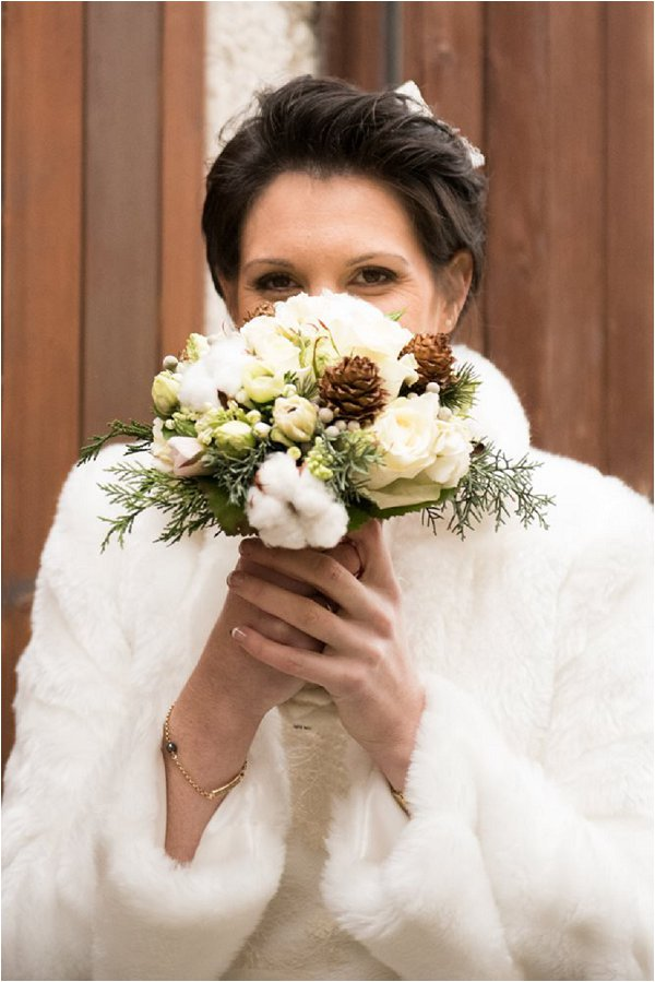 Gorgeous winter bride and her neutral bouquet