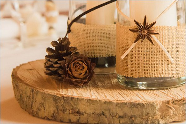 Wooden log centrepiece complete with pine cones and candles
