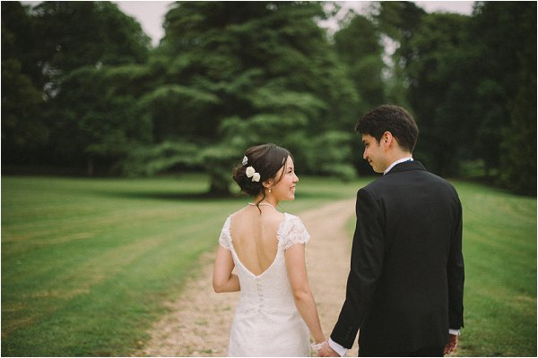 Bride and groom enjoy a stroll through the chateau grounds