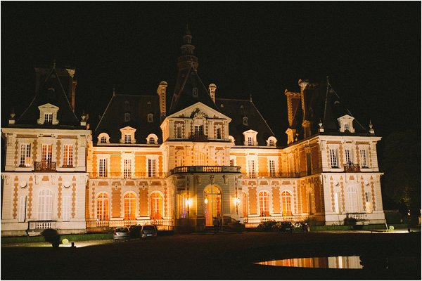 Chateau de Baronville exterior lit up at night