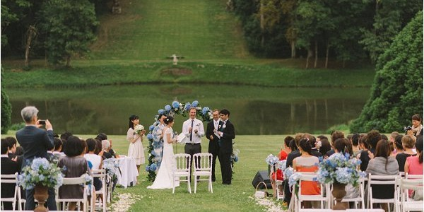 Idyllic lakeside wedding ceremony at Chateau de Baronville