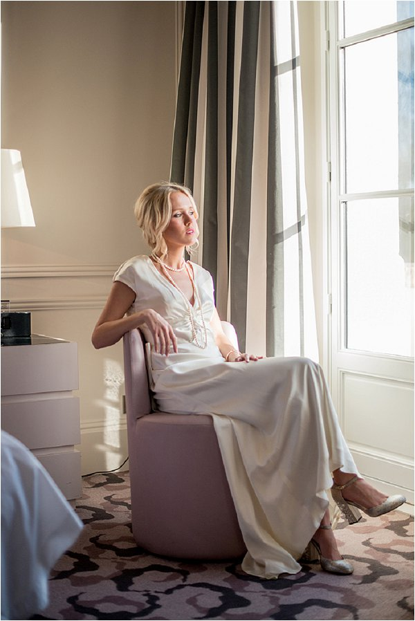 Bride relaxing by the window before the ceremony