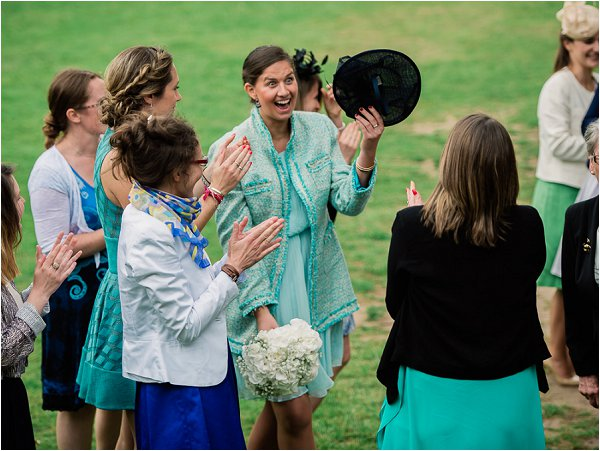 Delighted wedding guest catches the bouquet
