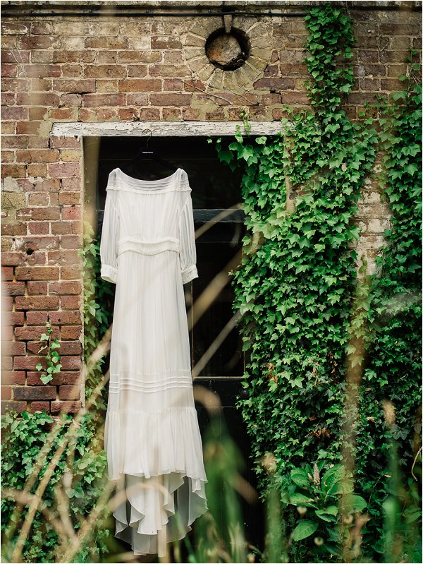 Delphine Manivet wedding dress hangs ready for the bride