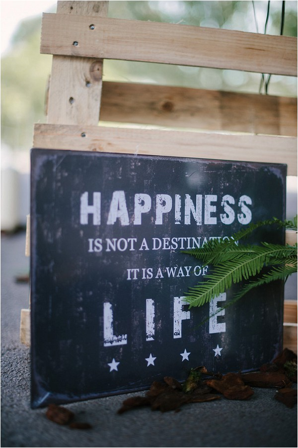 Happiness is not a destination sign