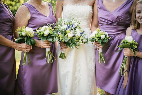 Lilac bridesmaids and white and blue bouquets
