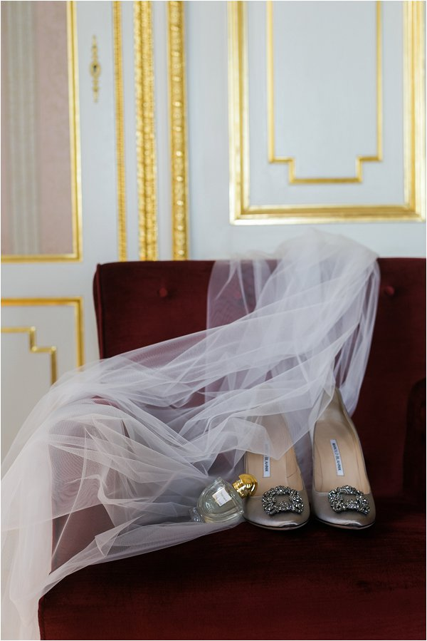 Silver buckle Manolo Blahnik shoes with wedding veil