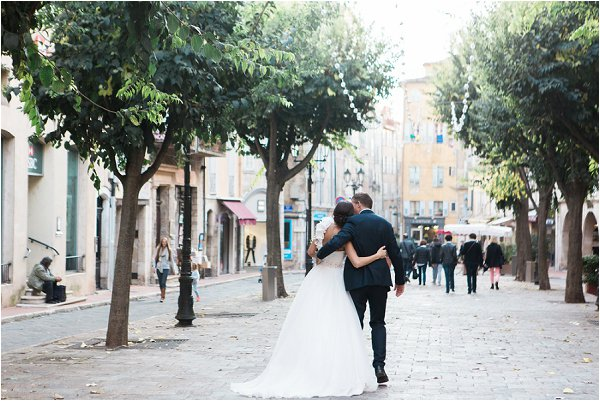 The happy couple arm in arm in central Grasse