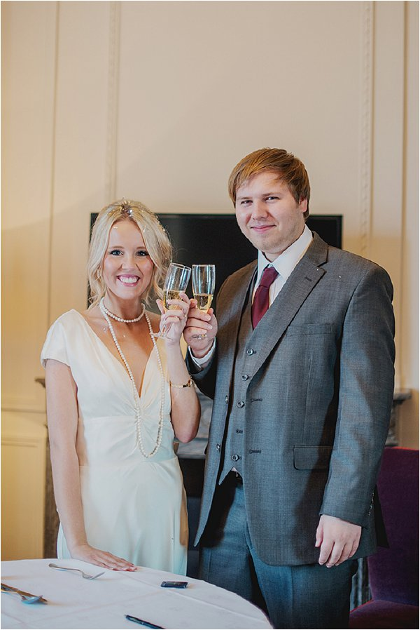The happy couple celebrate with champagne