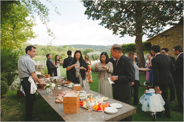 Wedding guests enjoying delicious local food