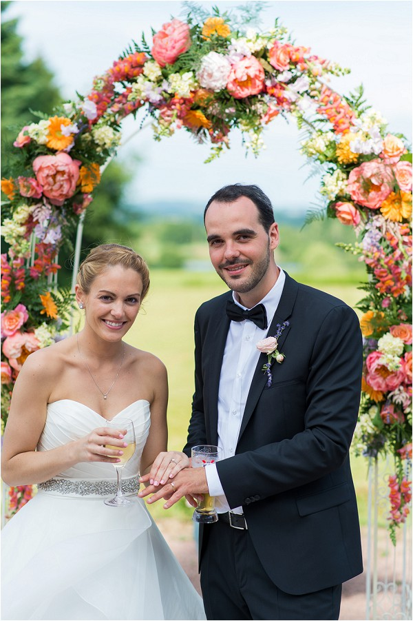 bright orange wedding flower arch