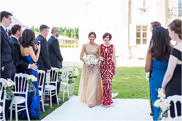 mother of the bride walking down aisle
