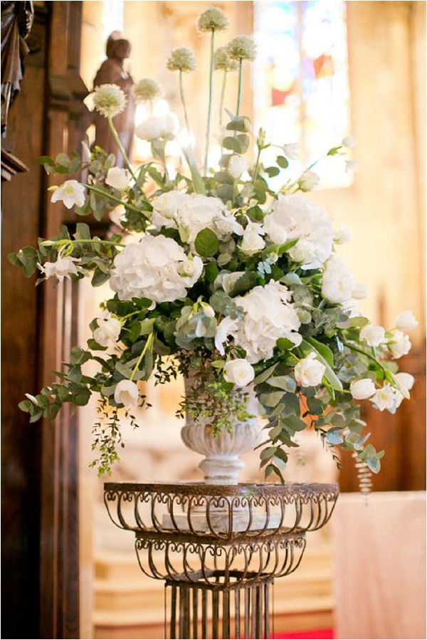 white wedding flower ceremony arrangement