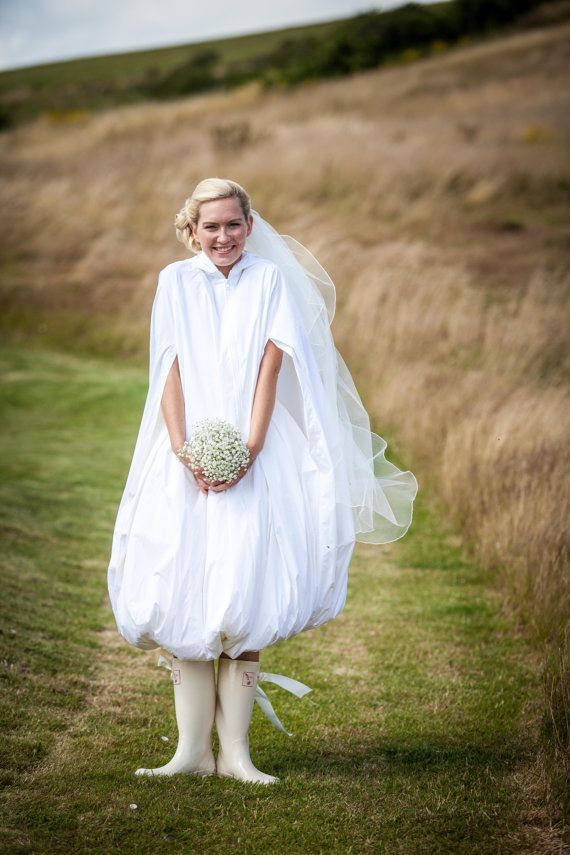 A waterproof bridal cloak to protect from rain, puddles and mudA waterproof bridal cloak to protect from rain, puddles and mud