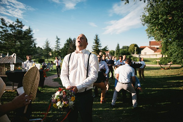 groom bouquet toss