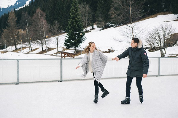 engaged couple ice skating