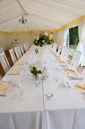 white and yellow wedding reception