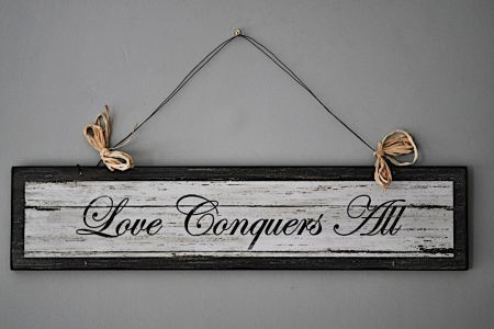 love conquers all sign
