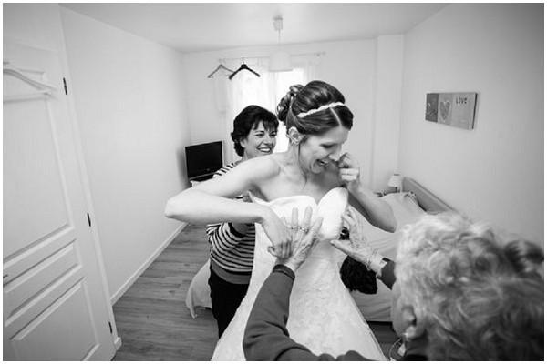 grandmother assisting bride_dress