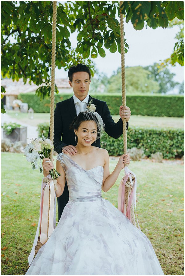 Bride Groom on a swing in rustic French countryside