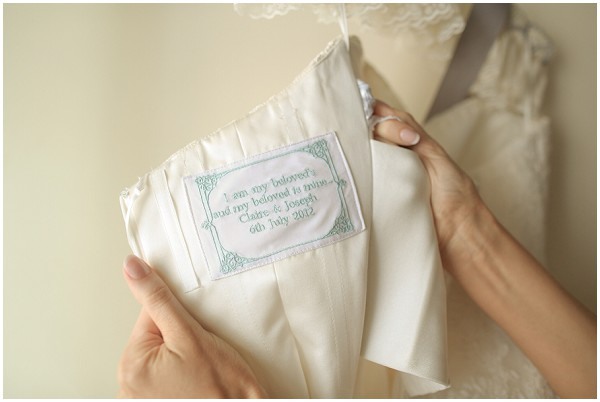 Embroidered message in wedding dress | Melissa Barrick Photography