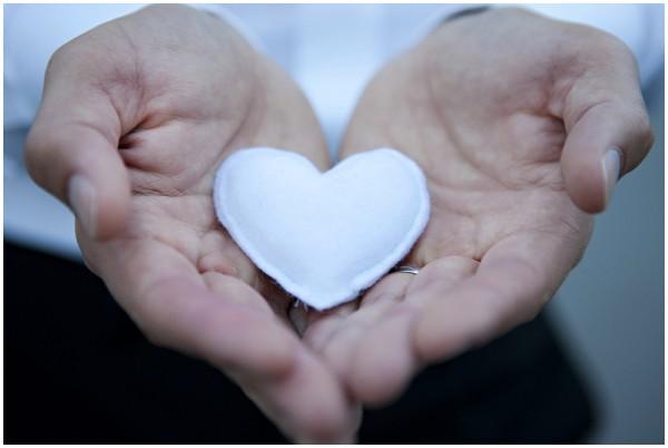fabric heart in hands