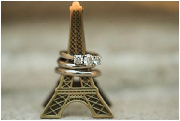 Paris wedding rings, on mini Eiffel Tower | Melissa Barrick Photography