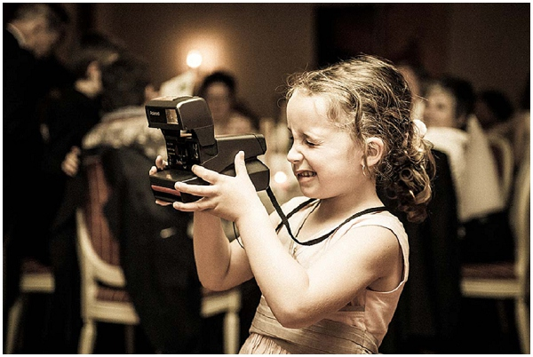 Young girl photography apprentice