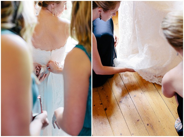 assisting bride into dress