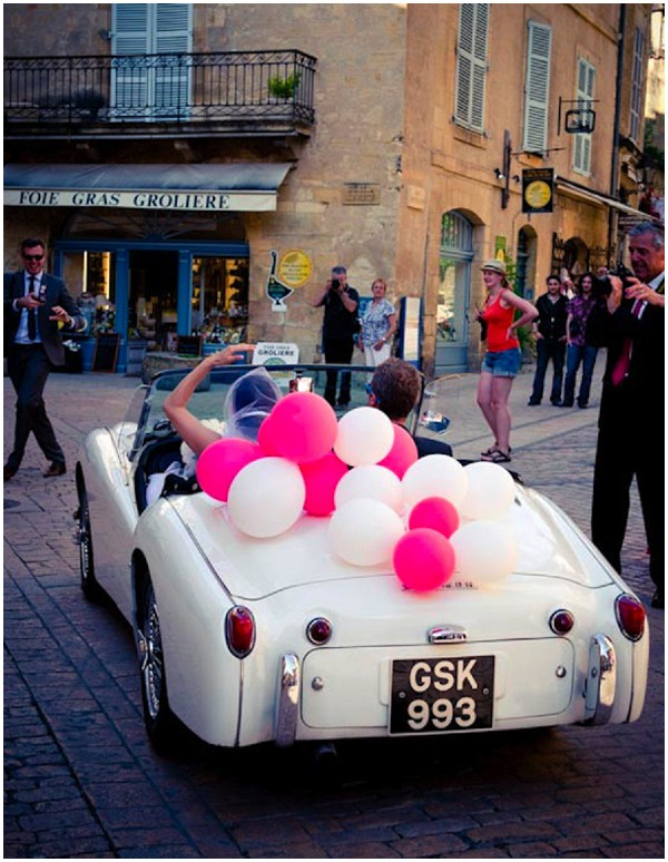 Vintage car with pink and white balloons