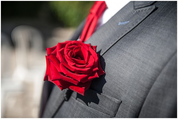 beautiful red rose buttonhole