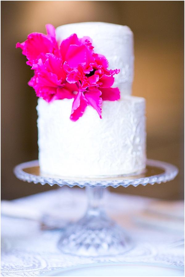 white cake fucshia flowers